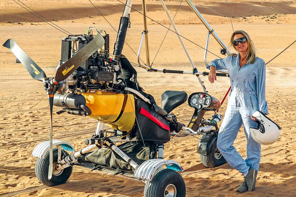 The author prepares for her microlight flight in Wahiba Sands | Image: Pelorus
